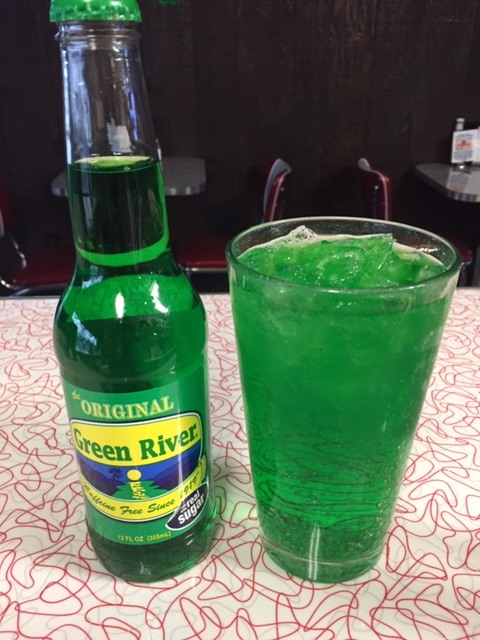 Green River Soda Bottle next to full glass.